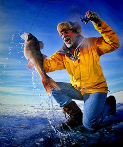 Dale hooks big walleye through the ice