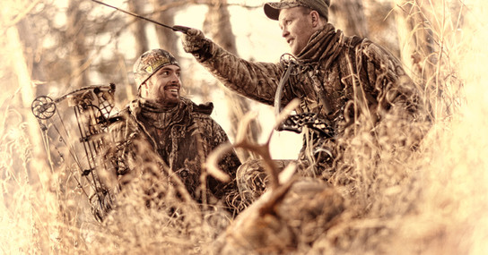 Two whitetail bowhunters happy with successful hunting