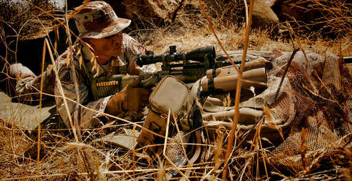 Police sniper lines up rifle on target