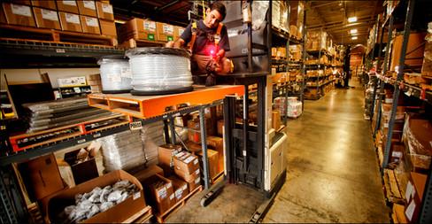 Warehouseman Scans Inventory