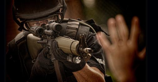 Swat team policeman arrests criminal