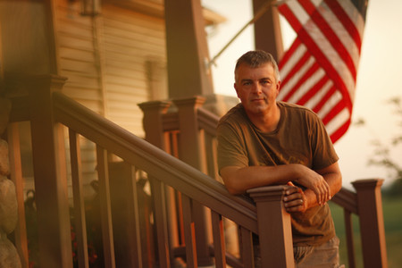 Farmer and US flag on Porch
