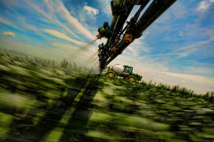 Soybean field sprayer at speed