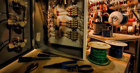 Factory Worker Assembles Electronics