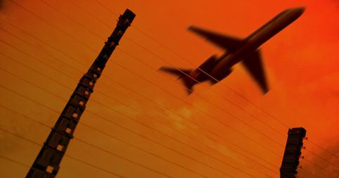 Jetliner Airplane Flies Over Security Perimiter Fence