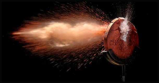 Visichalk target shattered by bullet in studio