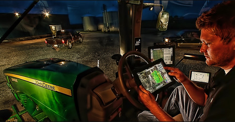 ipad in tractor cab on midwest farm