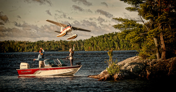 Waving to float plane at liftoff Lake Vermillion Minnesota