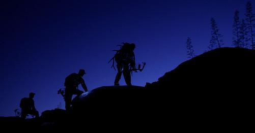 Elk Hunters on Ridge Backpack on Mountain