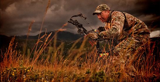 Archery hunter Tom Miranda stalks a Montana Mountain