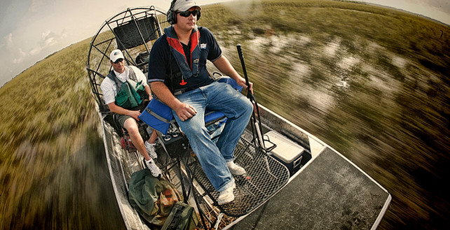 Chemical applicators use Airboat to Access Everglades