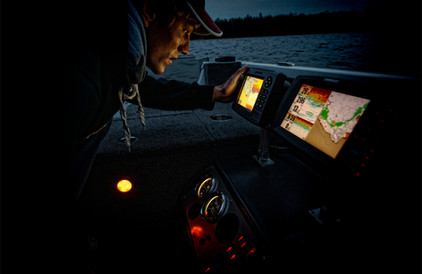 Viewing fishing electronics at night in boat