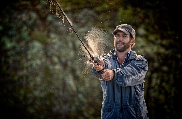 Fisherman casting lure