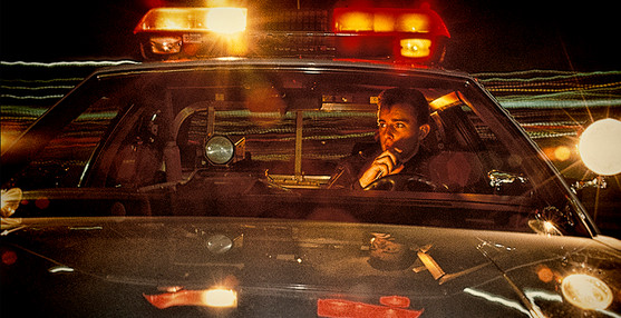 Police car at night answers emergency call