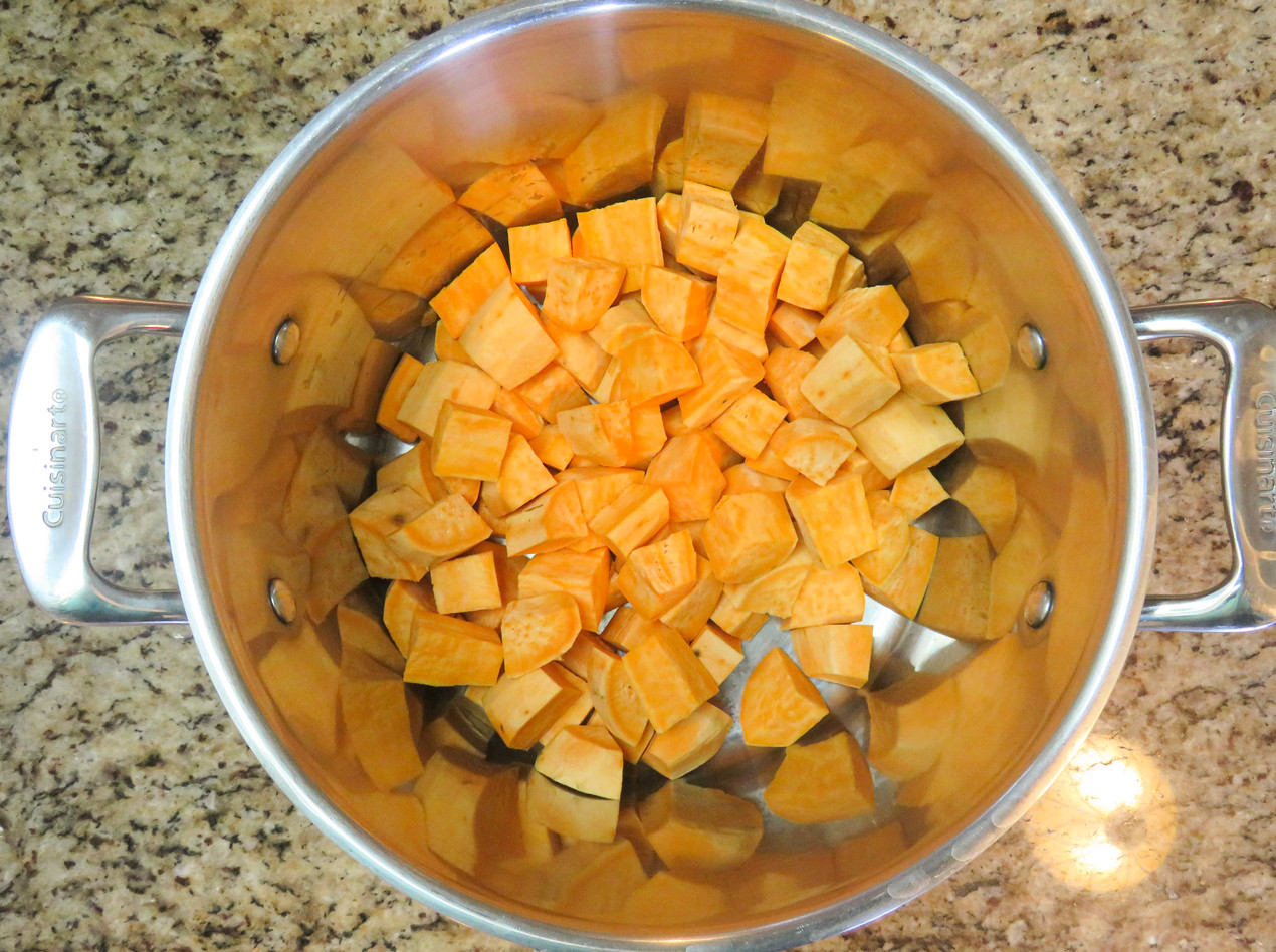 Sweet potatoes diced in a large pot ready for boiling.