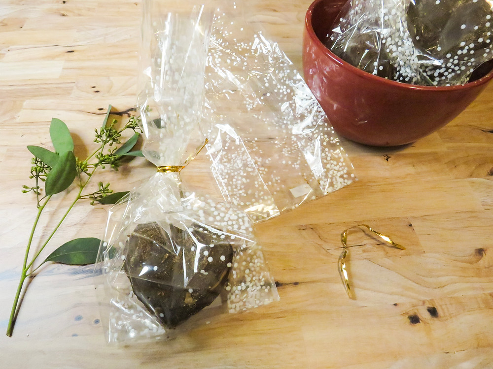 Hot cocoa bomb in a cellophane bag for gifting.