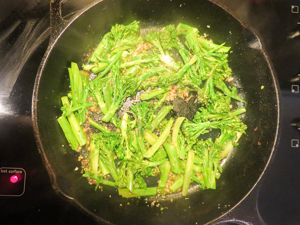 Broccolini cooked in olive oil, garlic, red chili flakes and lemon juice in the cast iron skillet.