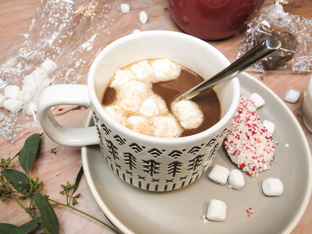 Hot chocolate topped with mini marshmallows in a giant mug.