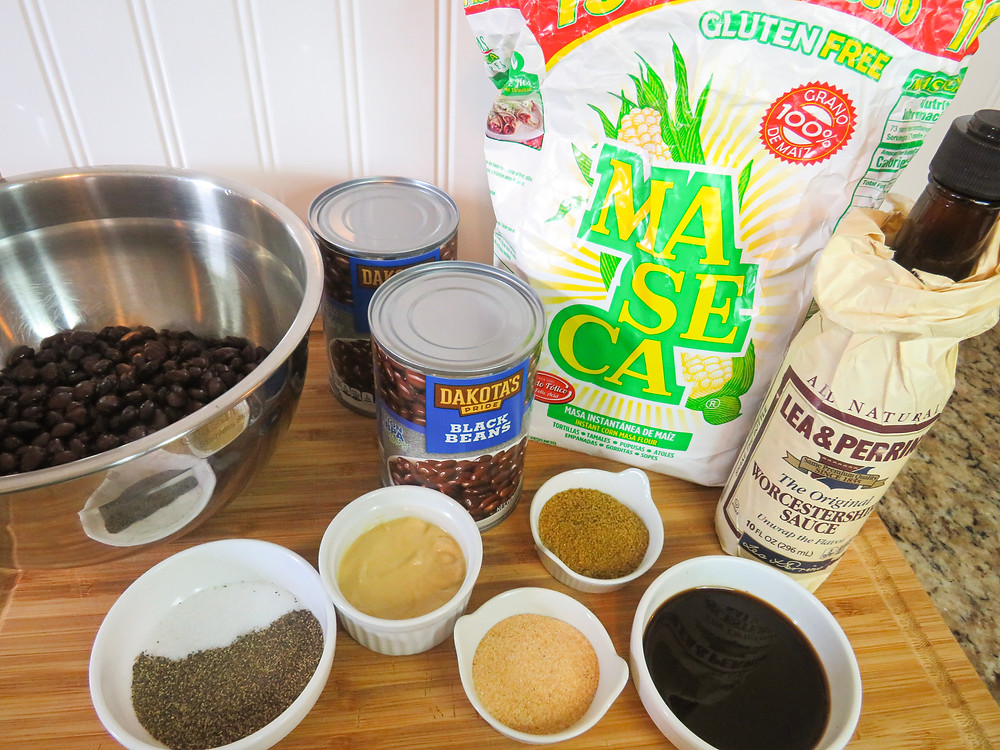 Ingredients of black bean cakes including spices, black beans, masa flour, and Worcestershire Sauce.