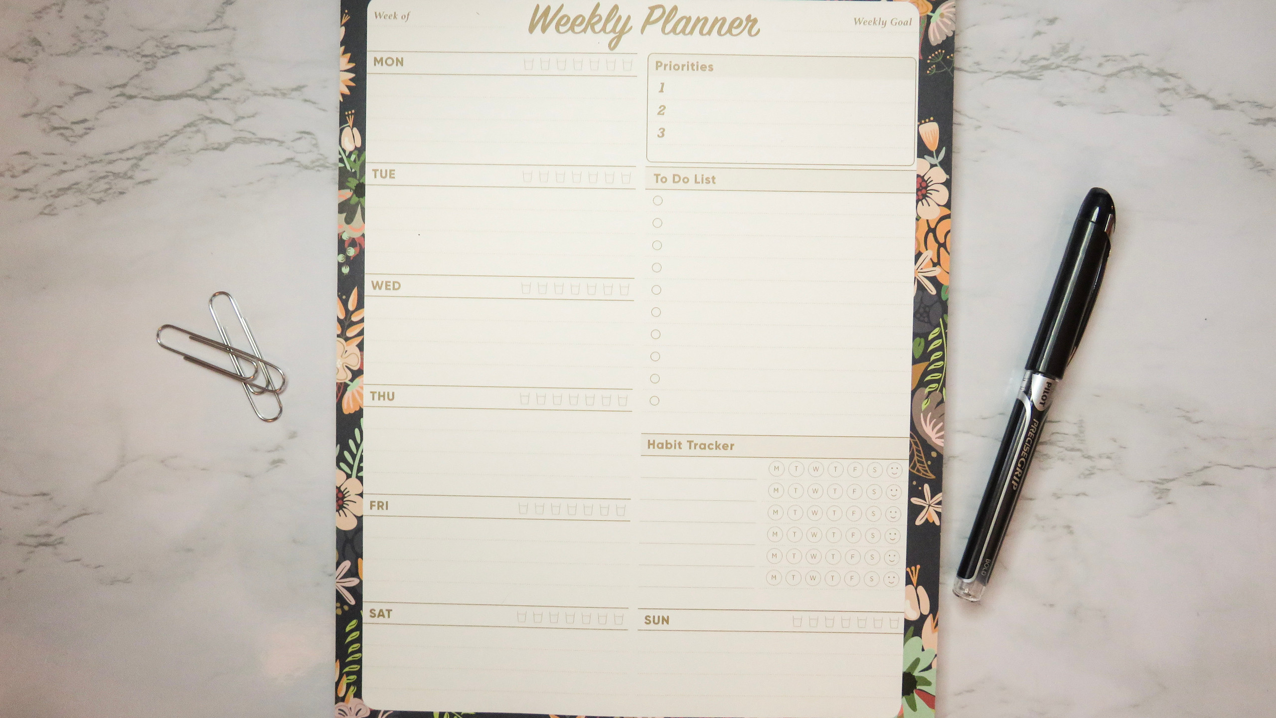 Oriday Weekly Planner Task Organizer Pad with a Navy Floral design