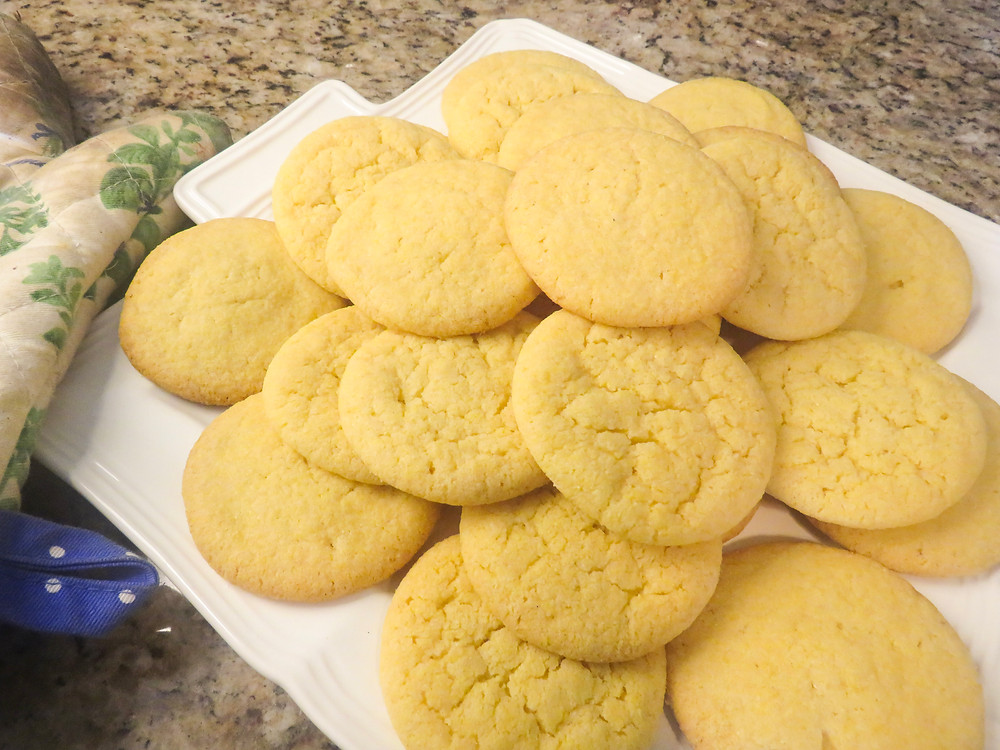 Pile of freshly baked sugar cookies on a platter.