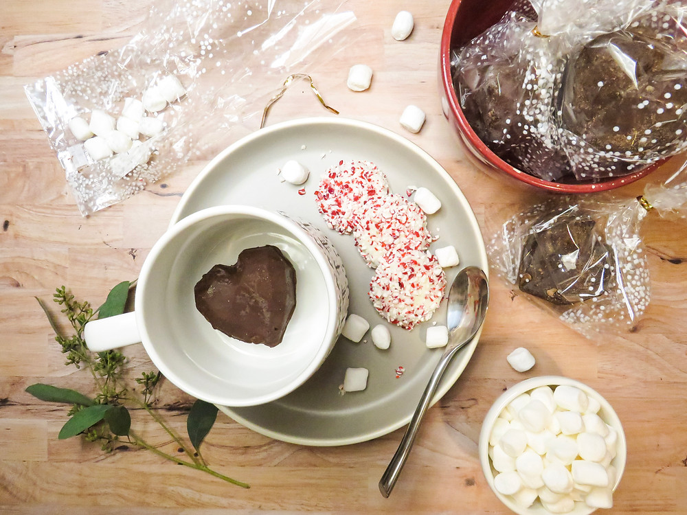 Heart shaped hot cocoa bomb in a mug