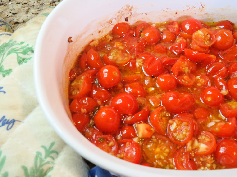 Roasted cherry tomatoes with garlic fresh out of the oven.