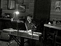 Performing at Smoky Bones 03 2014.png
