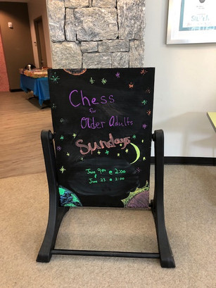 Chess for a Cause engaging Seniors at Milton Library