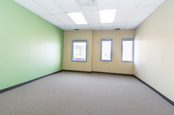 A second floor, very large office, which is big enough for two persons,