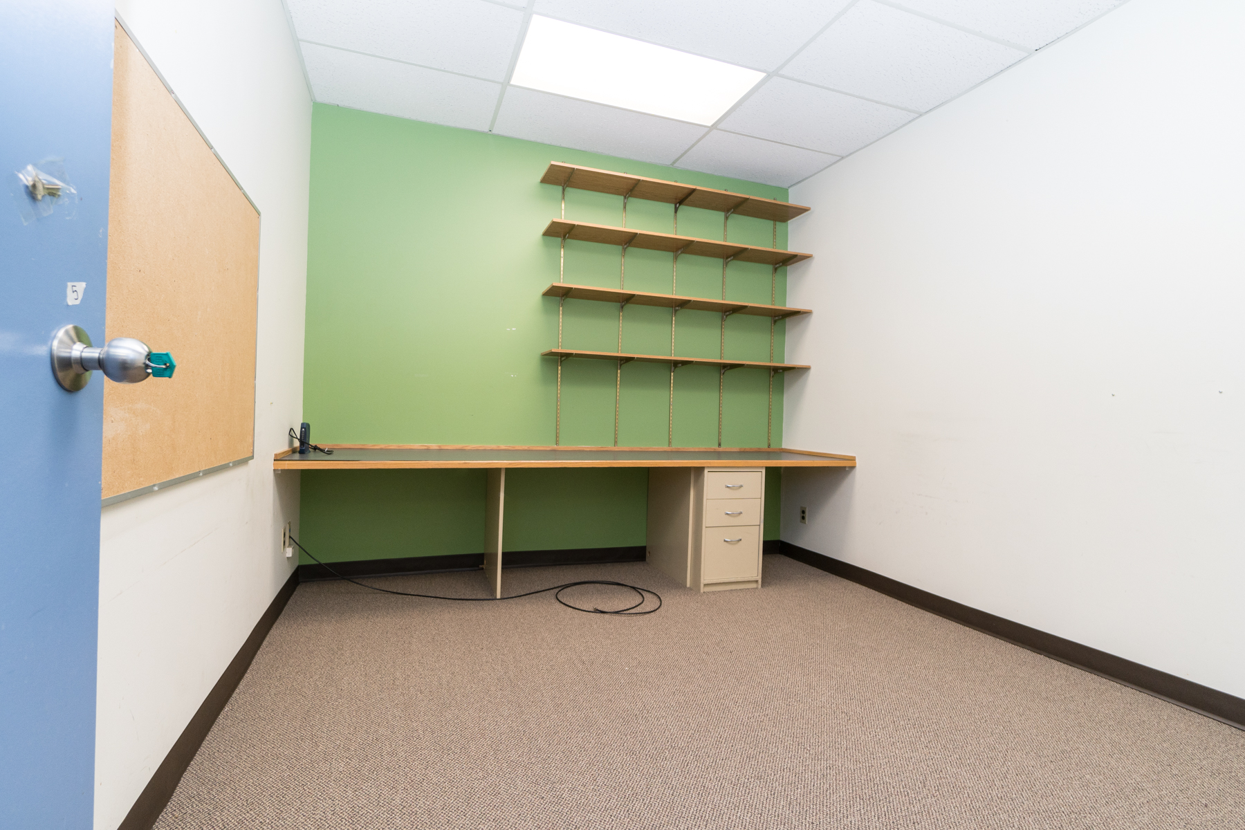 Even smaller offices have built-in shelving and desks,