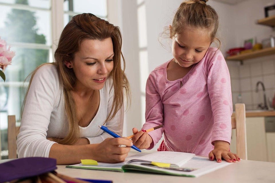 Parent motivating child to learn