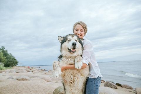 Canva - Woman Hugging Her Siberian Husky