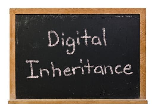 Digital Inheritance written in white chalk on a black chalkboard isolated on white.jpg