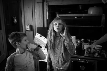 Family Dynamics Around Mum with Camera