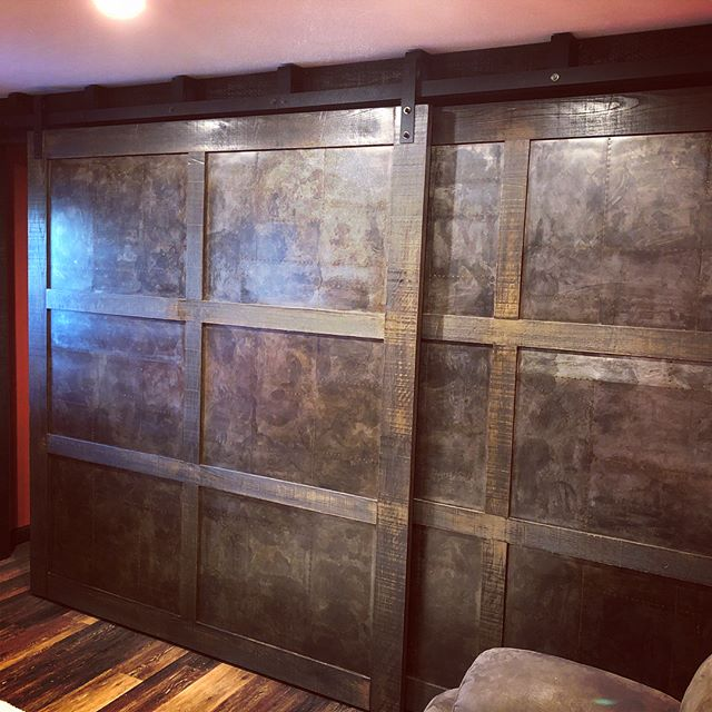 Massive wall to wall #barndoors sliders installed today! #doubletrack #redoak with #metal panels and