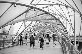 Black and white picture of the double helix bridge in Marina Bay, Singapore.