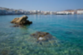 Photograph of the clear aquablue water of the greek island of Mykonoss.