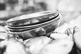 Black and white metallic bowls in the fish market, Tekka make, Singapore.