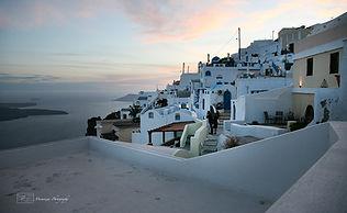 Photograph of sunset above the iconic greek island of Santorini.