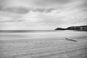 Black and white photograph of Manly Beach, Sydney, Australia.