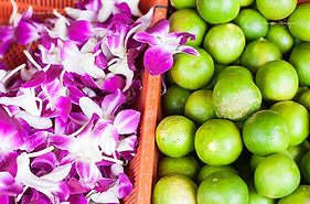 Limes and orchids in a shop in Little India, Singapore.