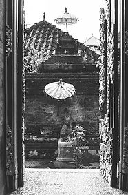 Black and white photograph of an opened door on a religios shrine, in Ubud, Bali.