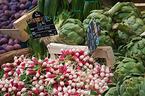 Close-up photograph on a vegetable stall in a local fresh market in France.