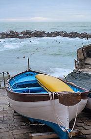 A blue load headind toward the sea, in Riomaggiore, Cinque terre, Italy.