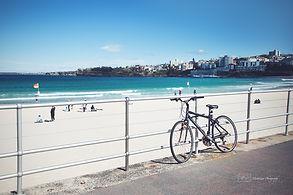 Bicycle on th sidewalk of Bondi Beach, Australia.