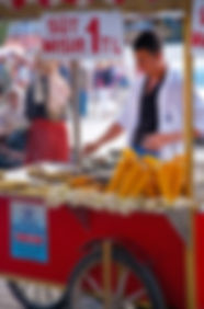 Photograph of a street vendor cooking grilled corn and chestnust in Istanbul,Turkey.