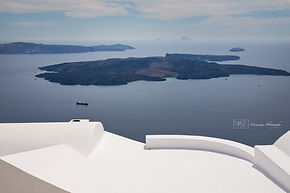 Photograph of sunrise above the iconic greek island of Santorini.