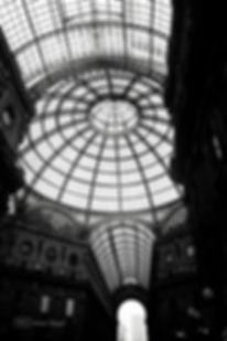 Black and white photograph of Galleria Vittorio Emanuele, Milan, Italy.