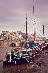 Fine art photograh of a sailing boat near a quay in Paris, France